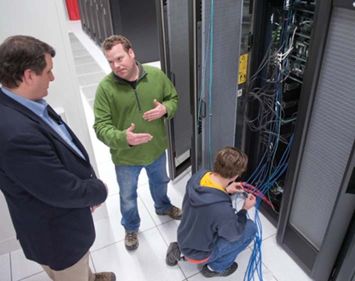 Chris Sedore, Duncan Brown, and Almir Alemic constructing the cluster.
